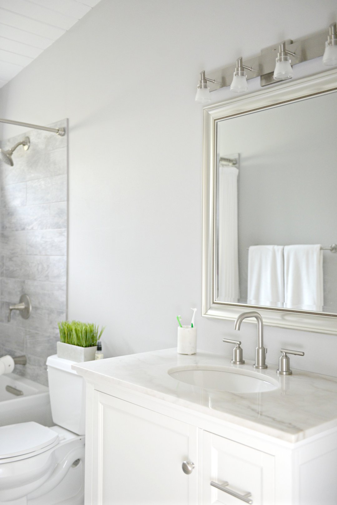 Bathroom update on a budget - easy budget friendly bathroom updates from Lowe's - Grey and white modern bathroom from Hello Splendid