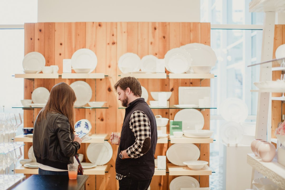 Couple registering for dinnerware at Crate and Barrel Private Registry Event