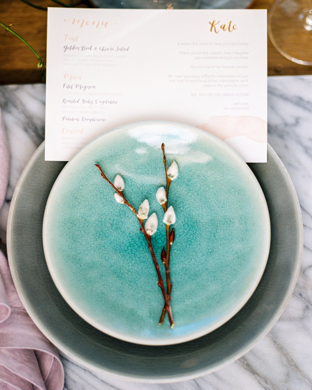 Aqua colored plates for wedding table setting