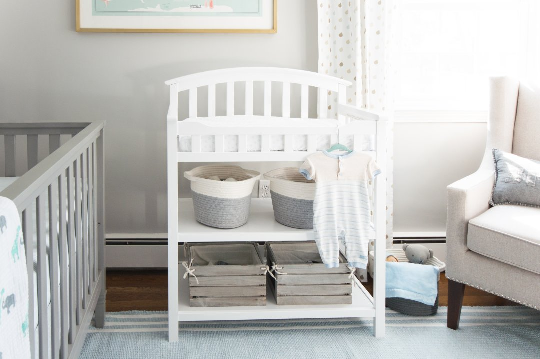 A classic gray and blue baby boy nursery featuring a reclaimed wood accent wood plus lots of ideas and inspiration to help you decorate for your own bundle of joy!