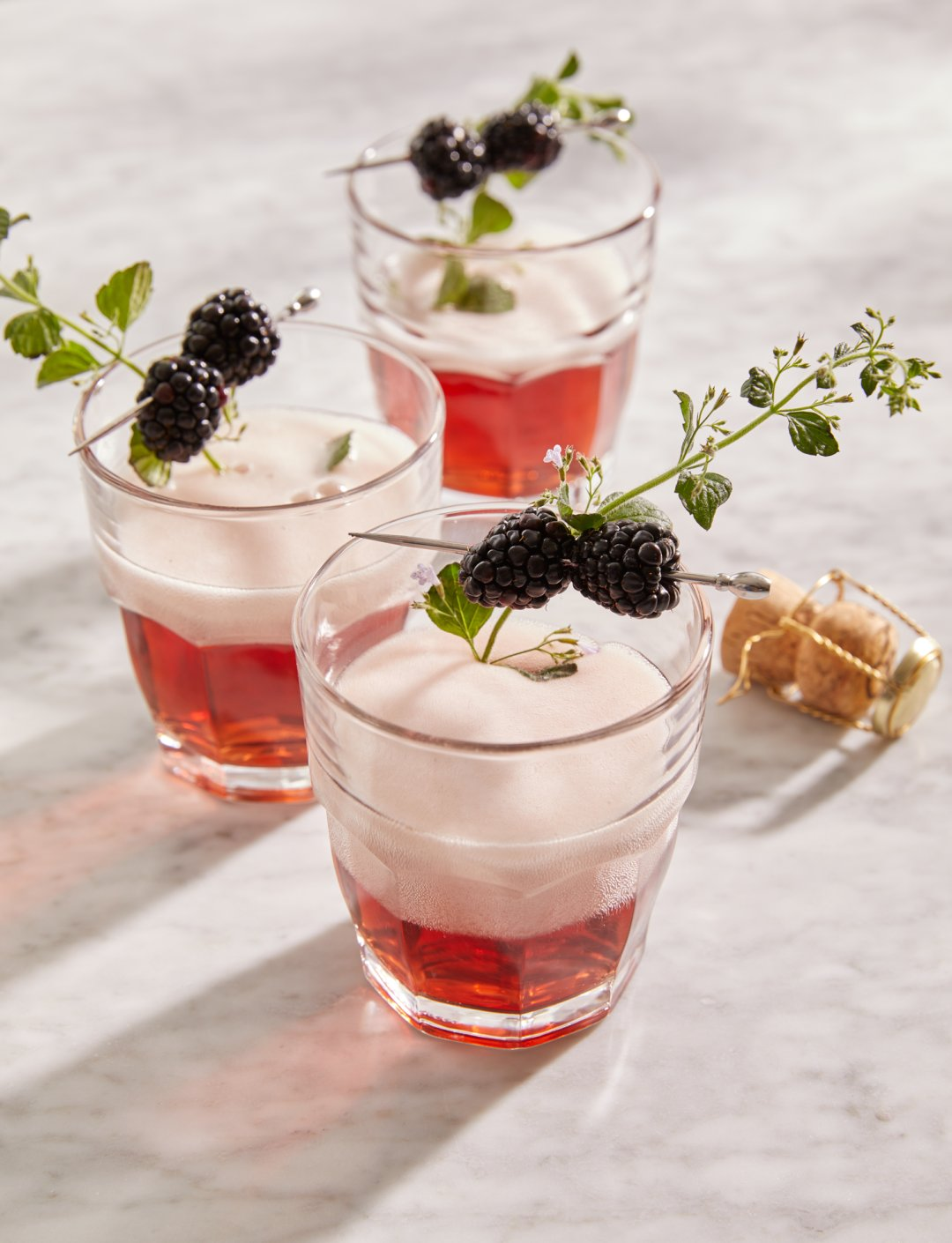 Kir Royale served with a blackberry garnish