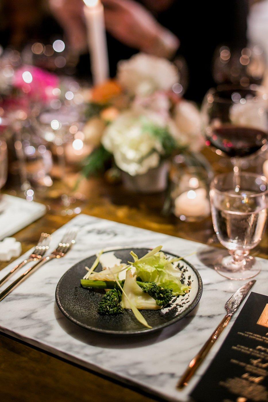 Salad on black salad plate and marble platter