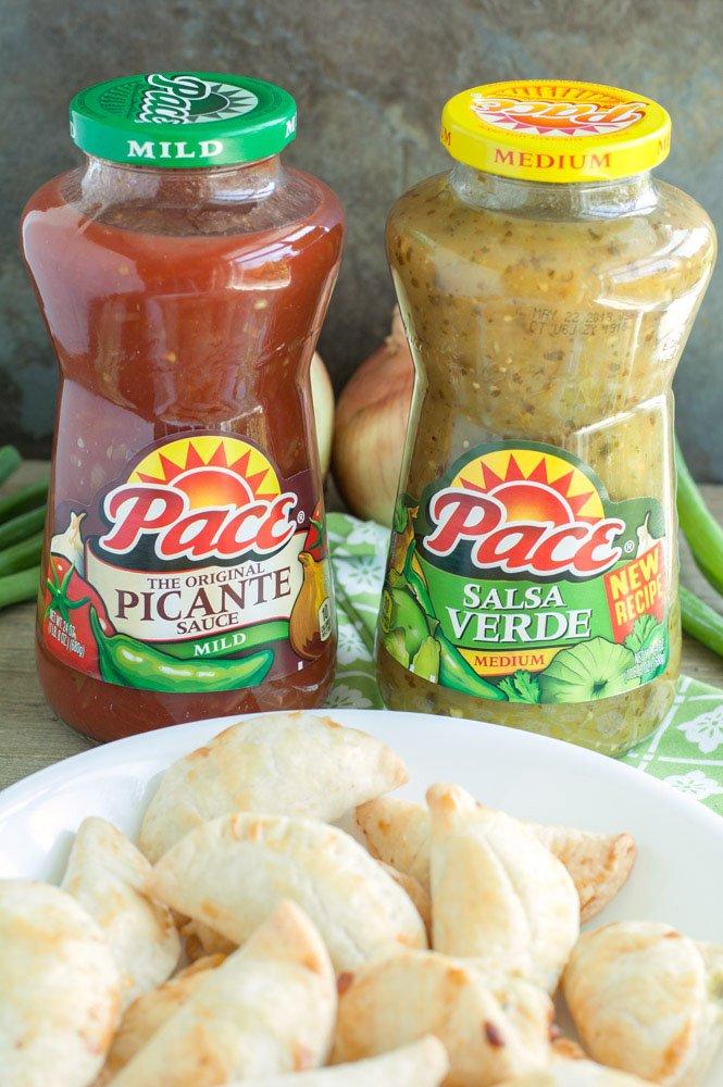Empanadas with 2 jars of salsa.