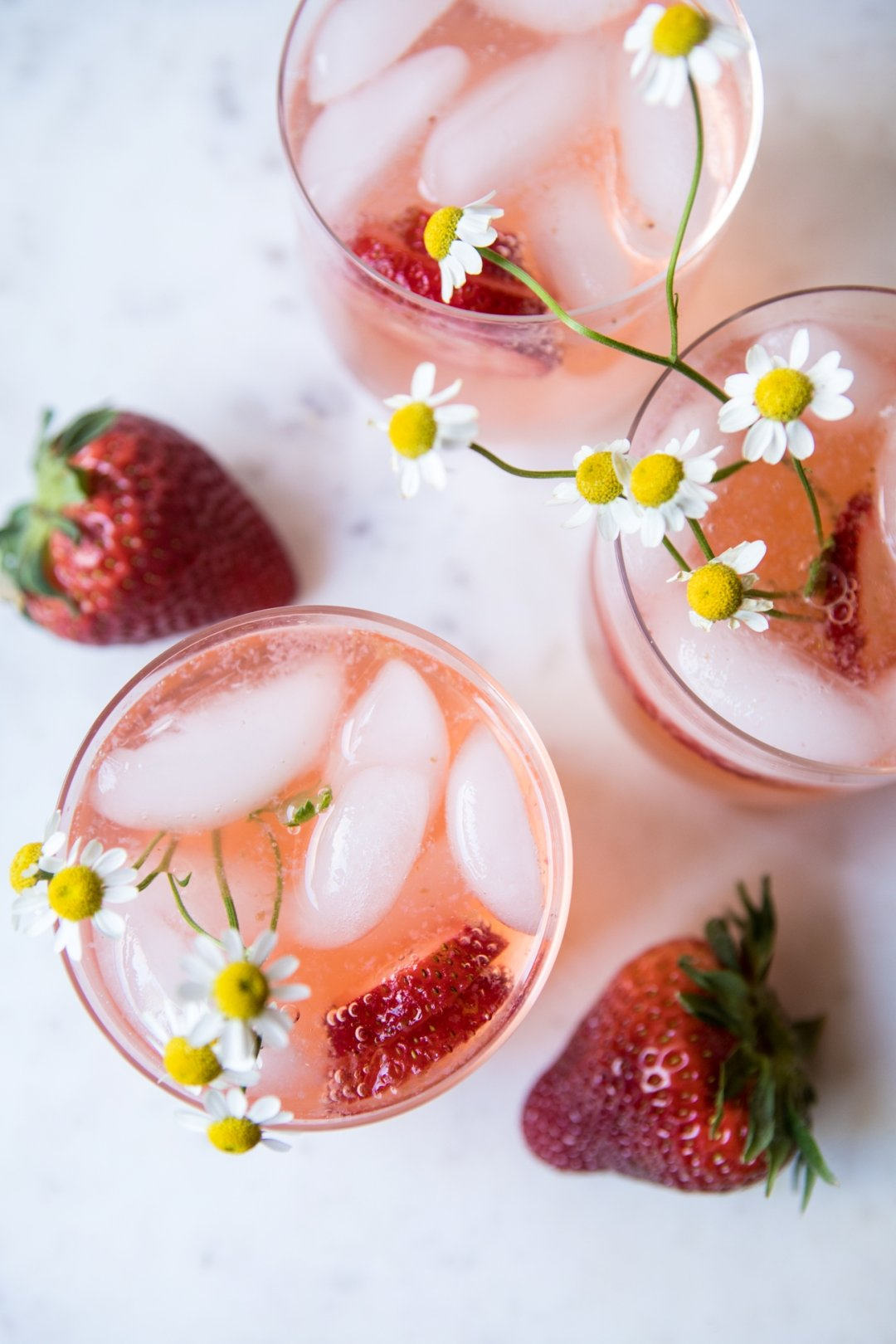 Pink palomas with strawberries and daisies