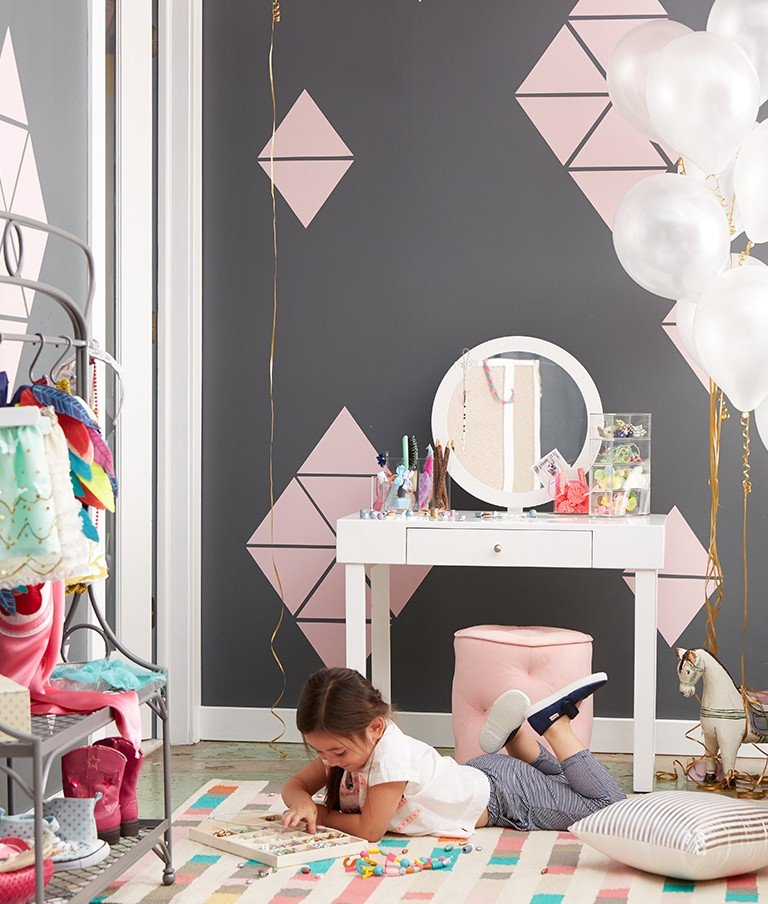 Pink wall decals add exciting pattern to a young girls bedroom walls.
