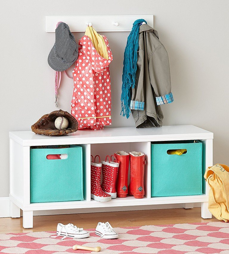 An entryway storage bench with shoes