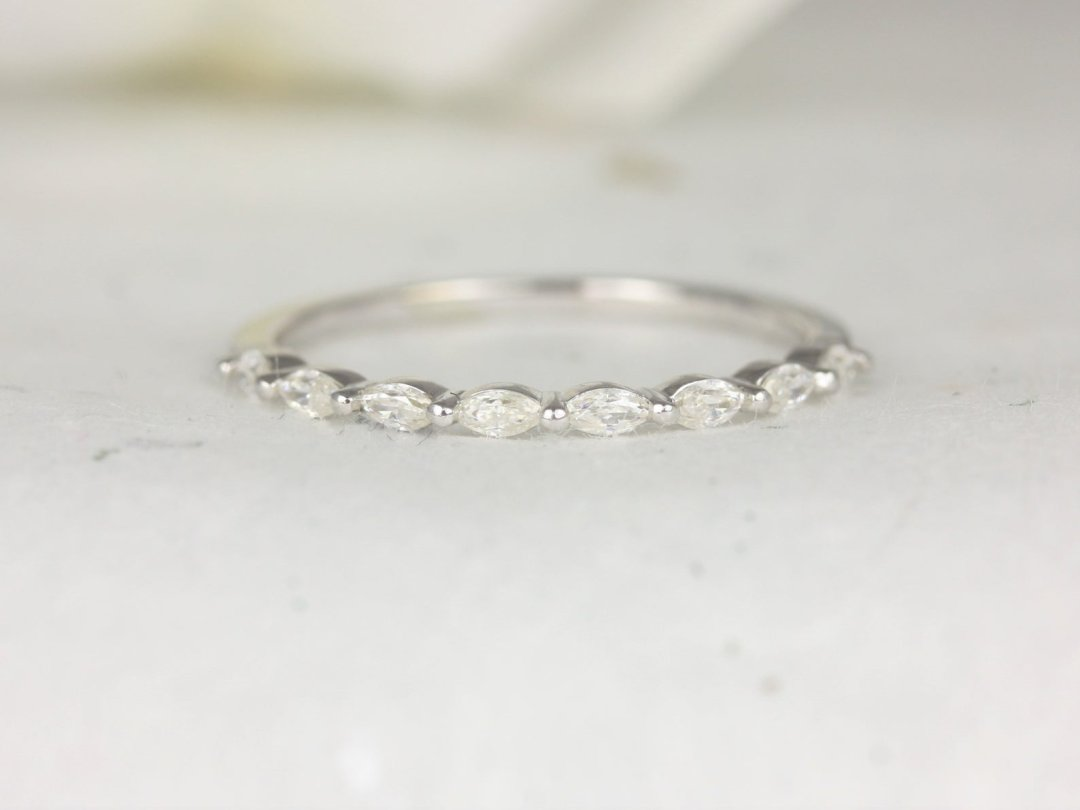 white gold band with forever one moissanite stones