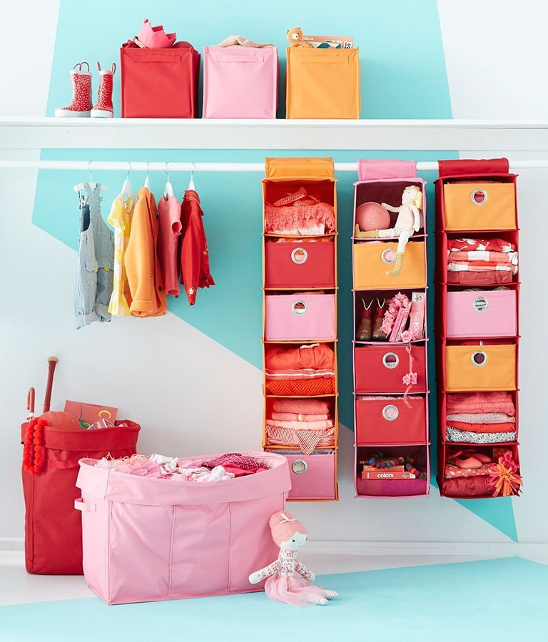 A closet organized with hanging canvas bins, cube storage and more..