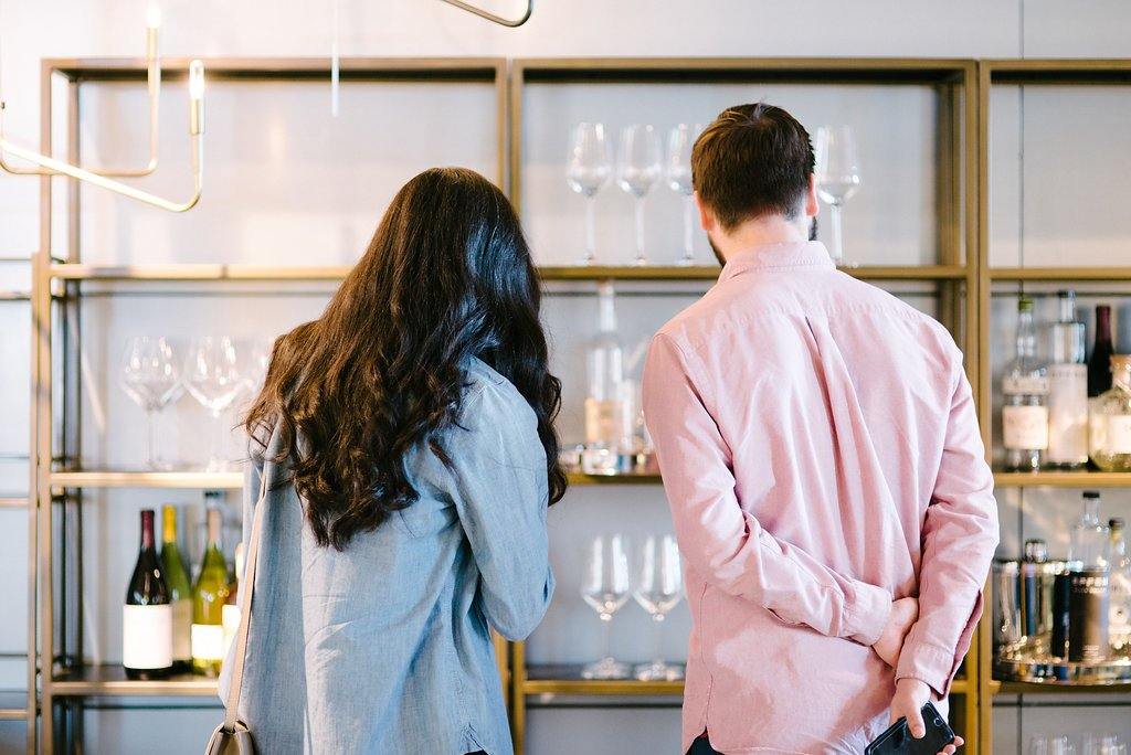 Couple looking at cocktail glassware at Crate and Barrel Private Registry Event