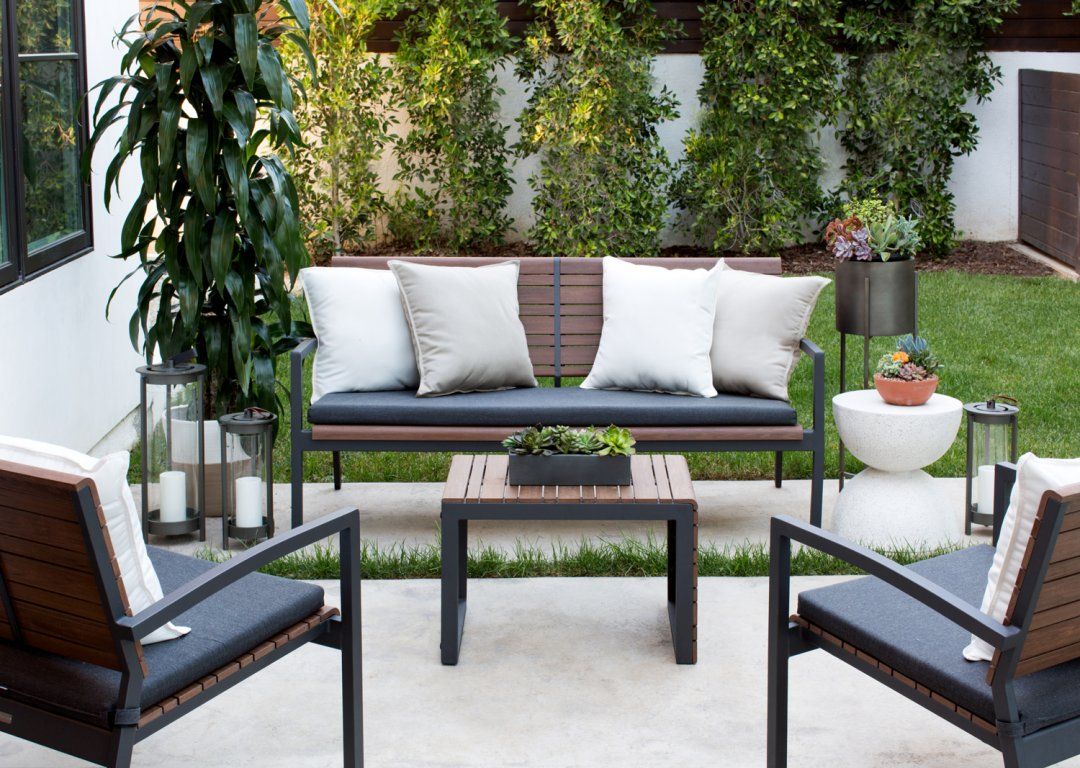 Wood and metal outdoor furniture in backyard