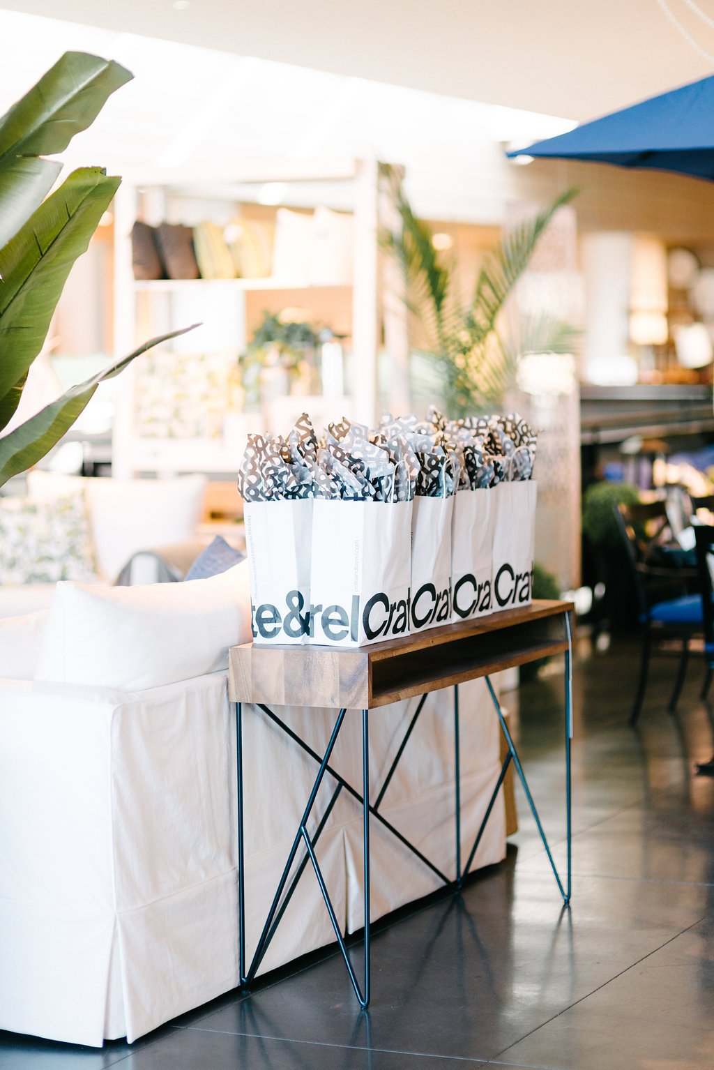 Gift bags displayed on console table at Crate and Barrel Private Registry Event