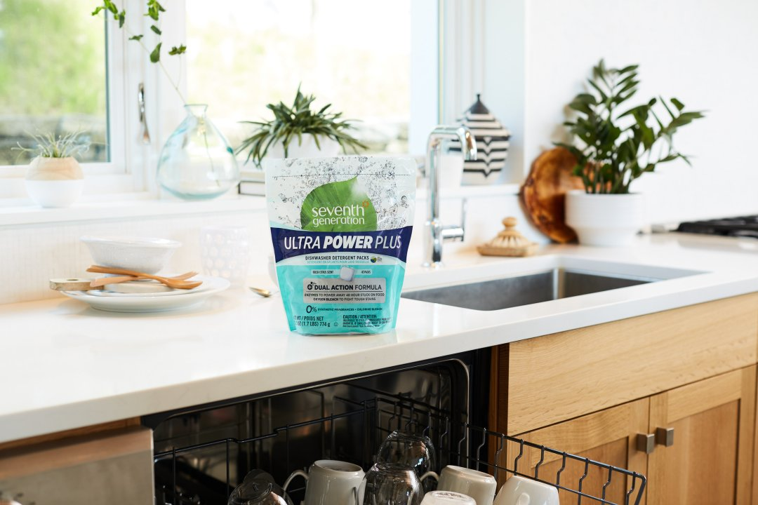 Ultra Power Plus Dishwashing Packs on counter over open dishwasher