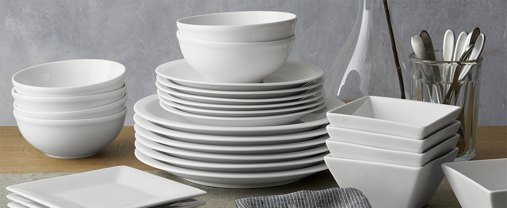 White dinnerware, including dinner plates, salad plates, bowls and serveware