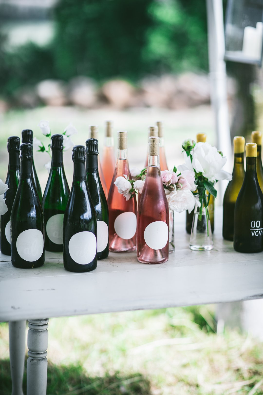 Chilled Champagne and Rose bottles on table