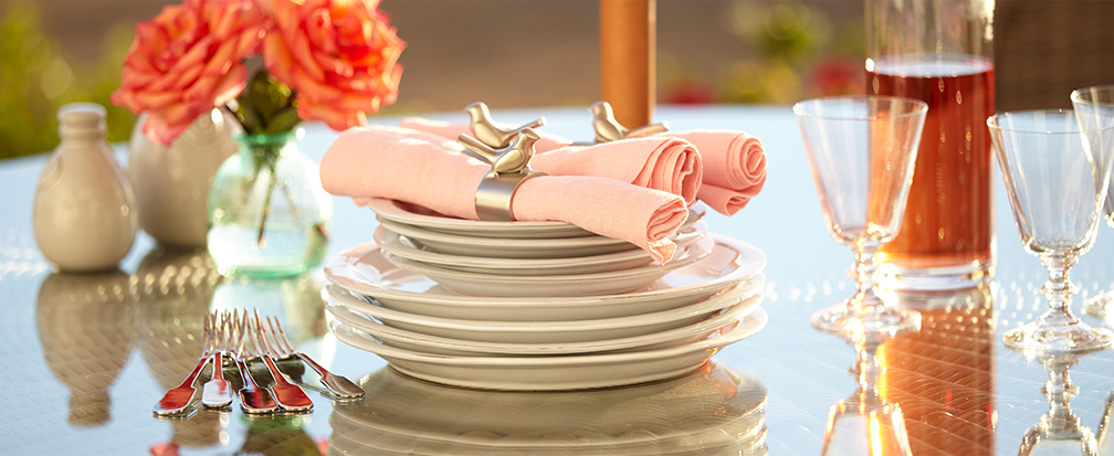 Outdoor dinnerware with napkin holders and peach flowers