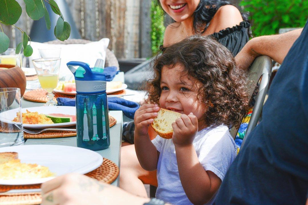 Kid eating slice of toast