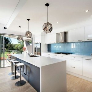 design kitchen lighting ideas this modern kitchen shines with these metal pendants and glossy back splash homedsgn how to light kitchen expert design ideas tips