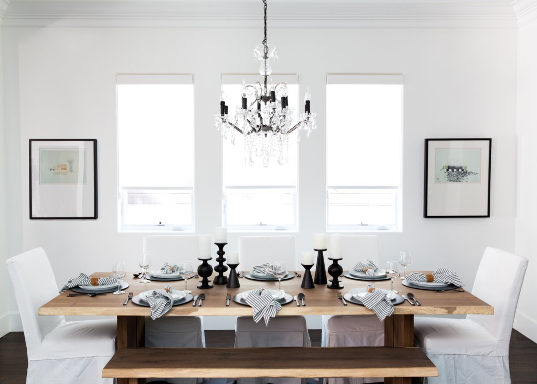 Blue, white and black dinnerware on wood dining table