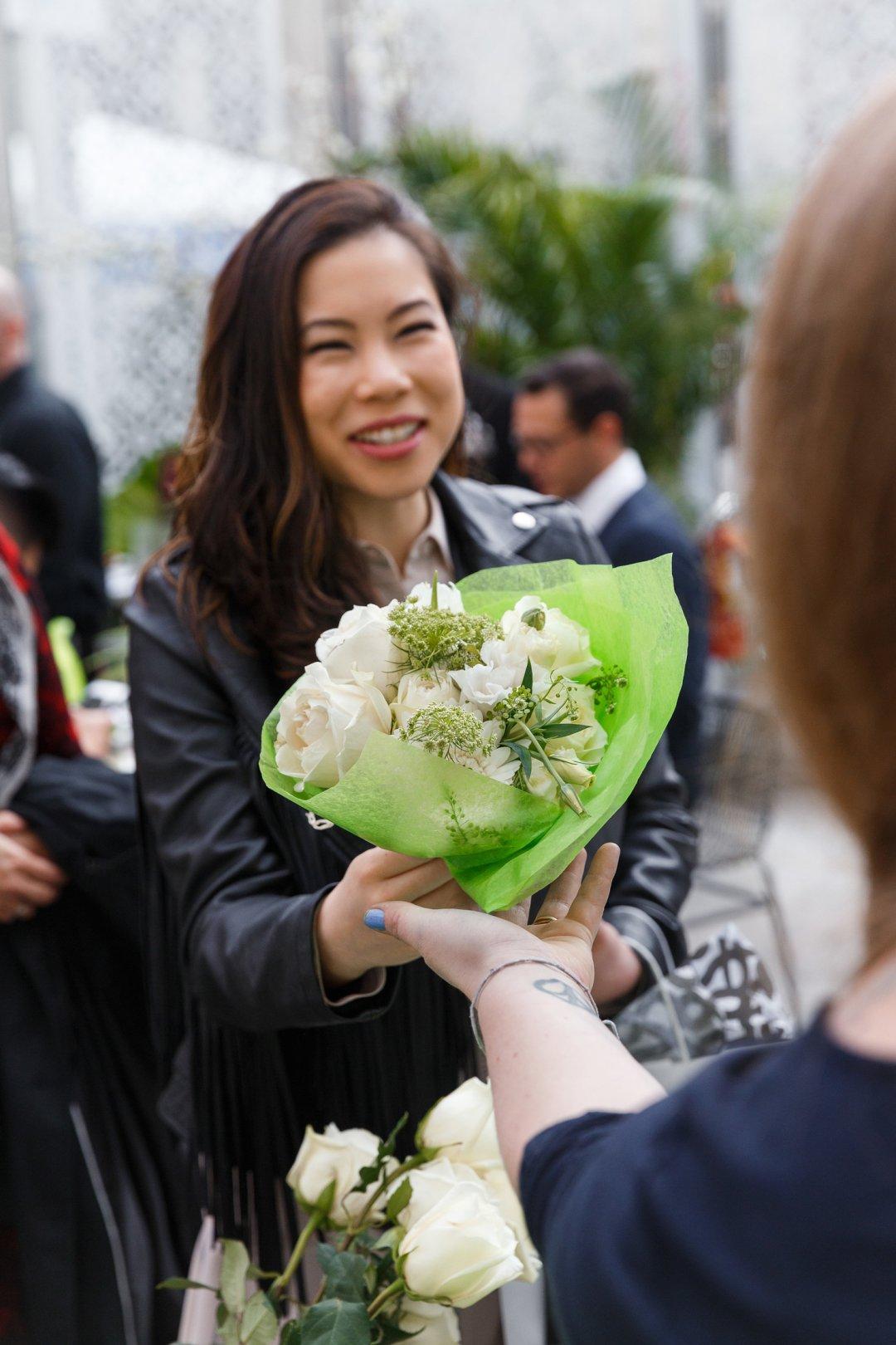 Woman receiving white floral bouquet