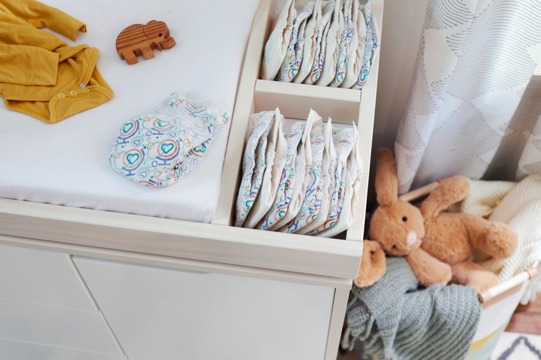 new baby diapers in changing table drawer