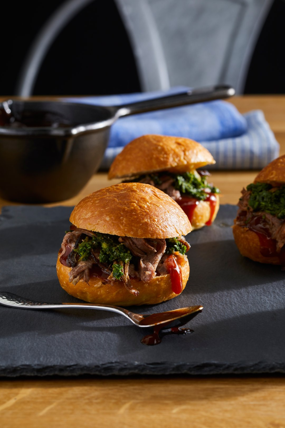 Barbecue braised ribs sliders on a slate cheese board