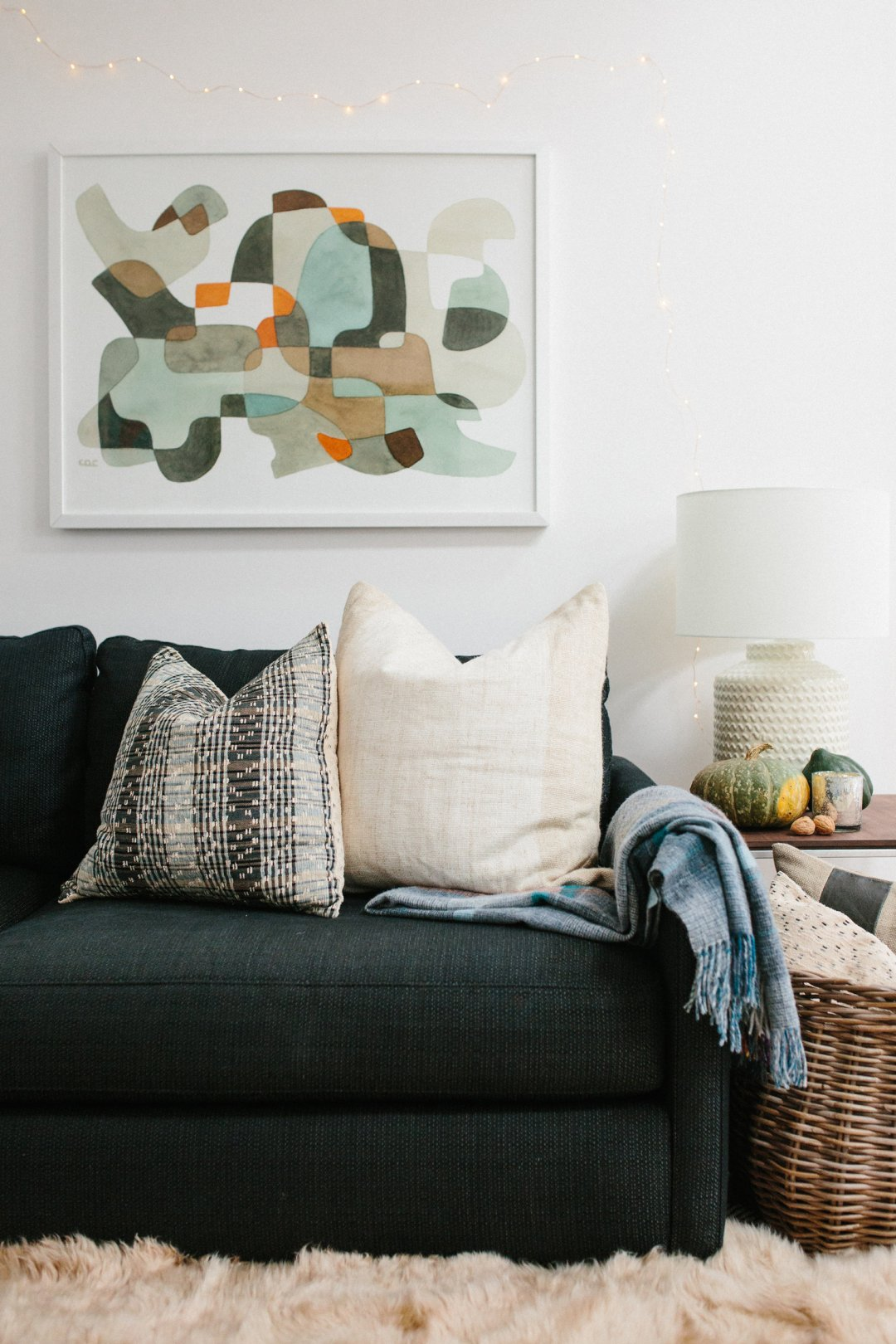 'Cozy living room decor and fluffy throw pillows on a fabric sofa in navy blue