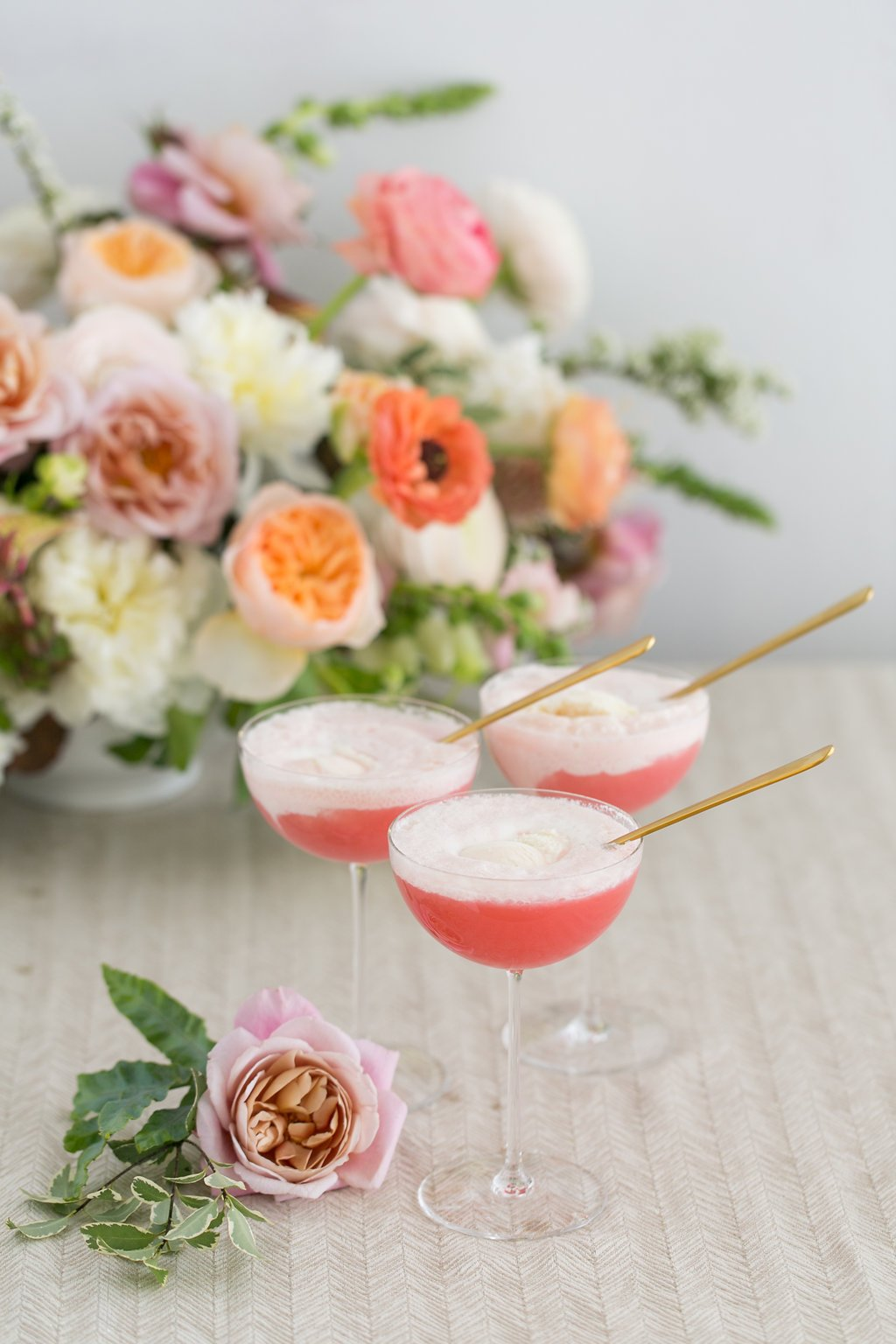 Three glasses of frose with gold spoons