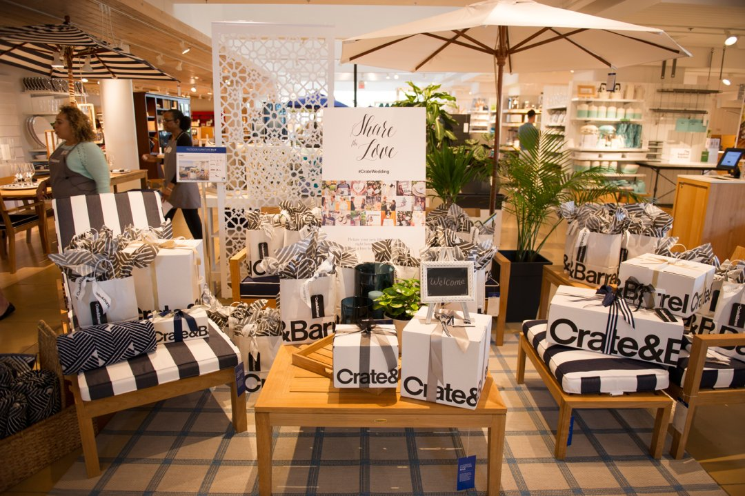 Collection of Crate and Barrel boxes displayed at Private Registry Event