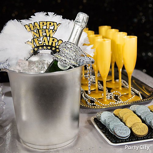 curated image with silver plastic ice bucket gold happy new year feather tiara