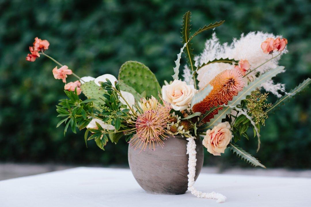 Grey vase with flower centerpiece