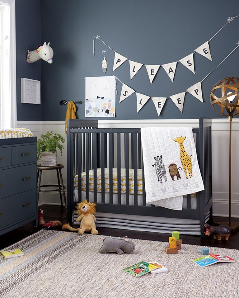Navy blue boys nursery with safari theme.