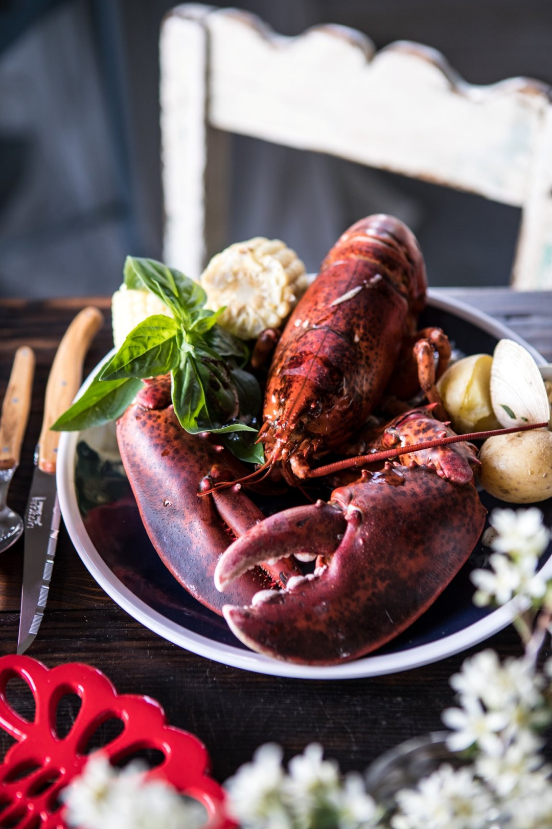 Cooked lobster on plate on dinner table