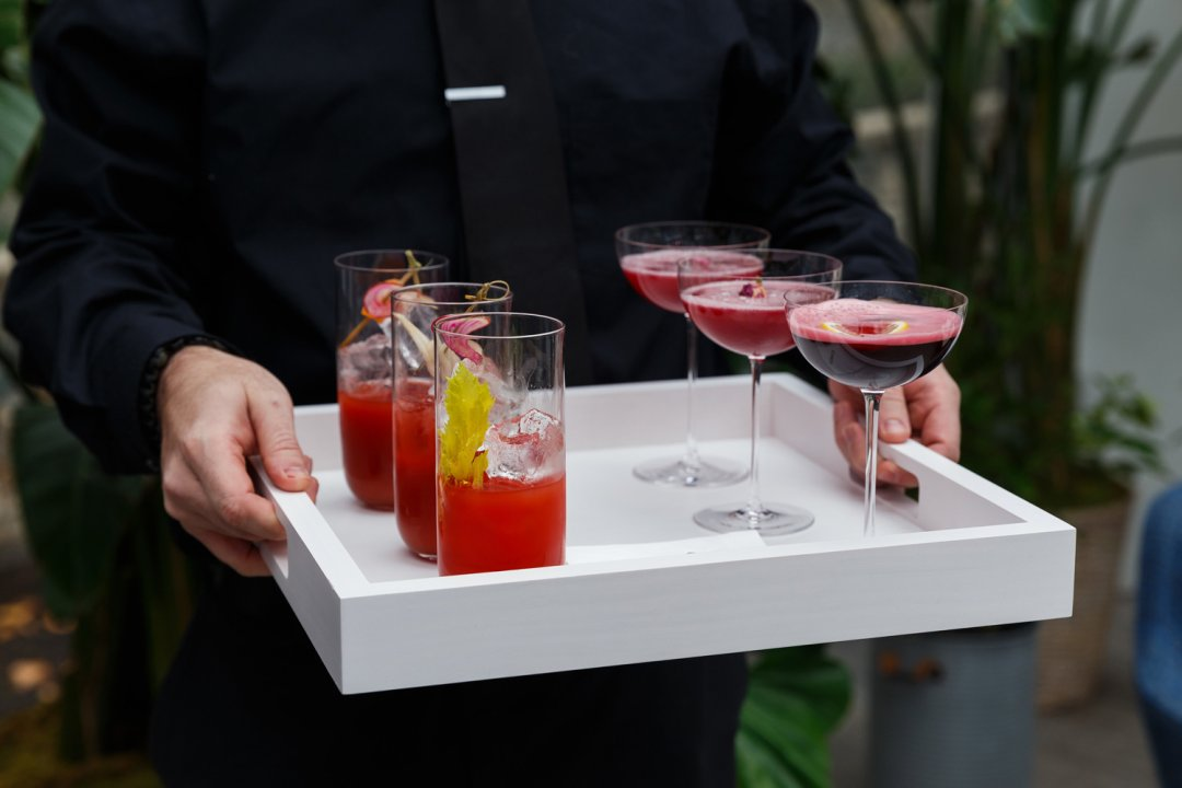 Rose cocktails on a white tray