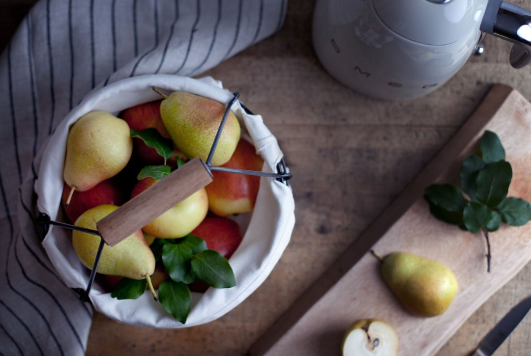 Fresh apples and pears in a cloth lined bucket