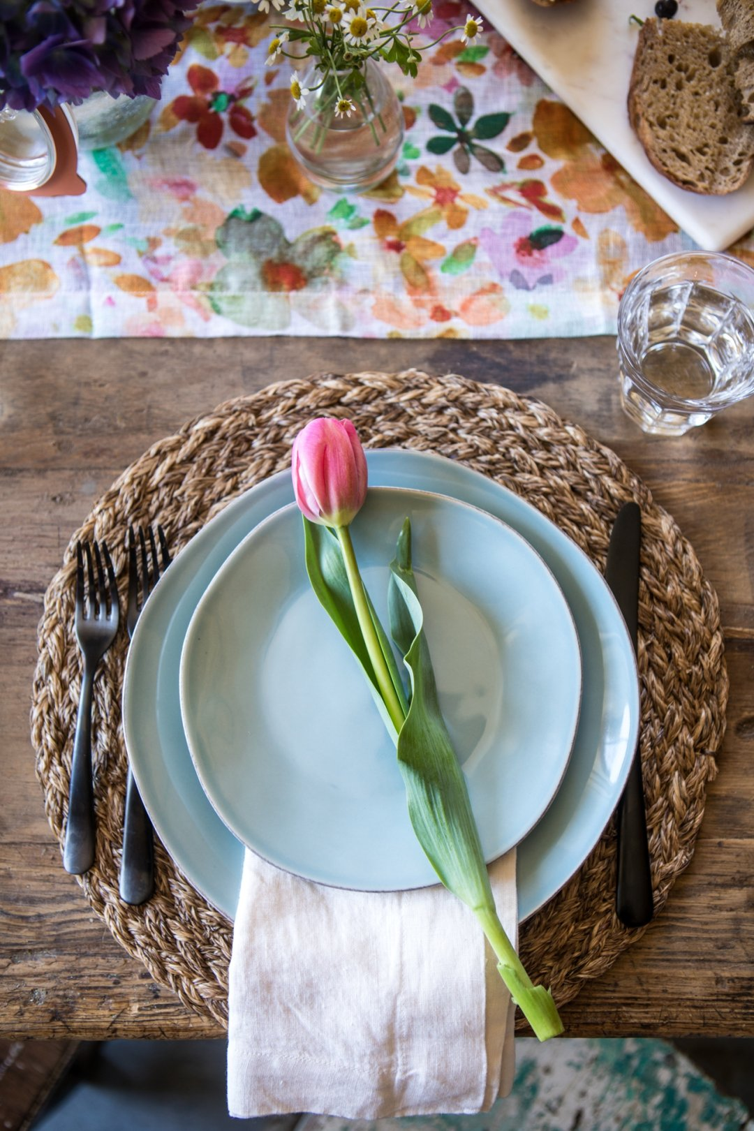 Blue plates with a pink tulip on top