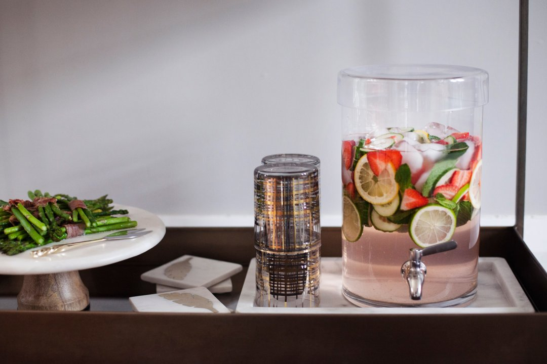 Strawberry Cucumber water and a platter of asparagus on a bar cart