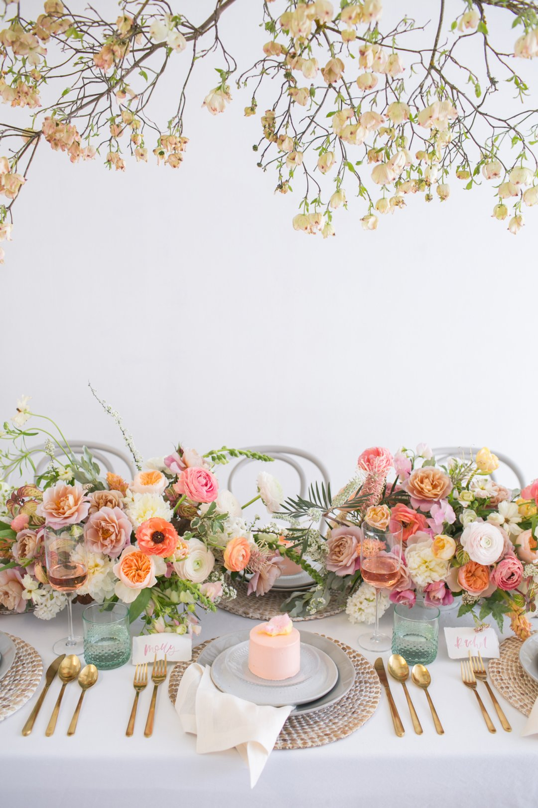 Floral tablescape for bridal shower with blush tones