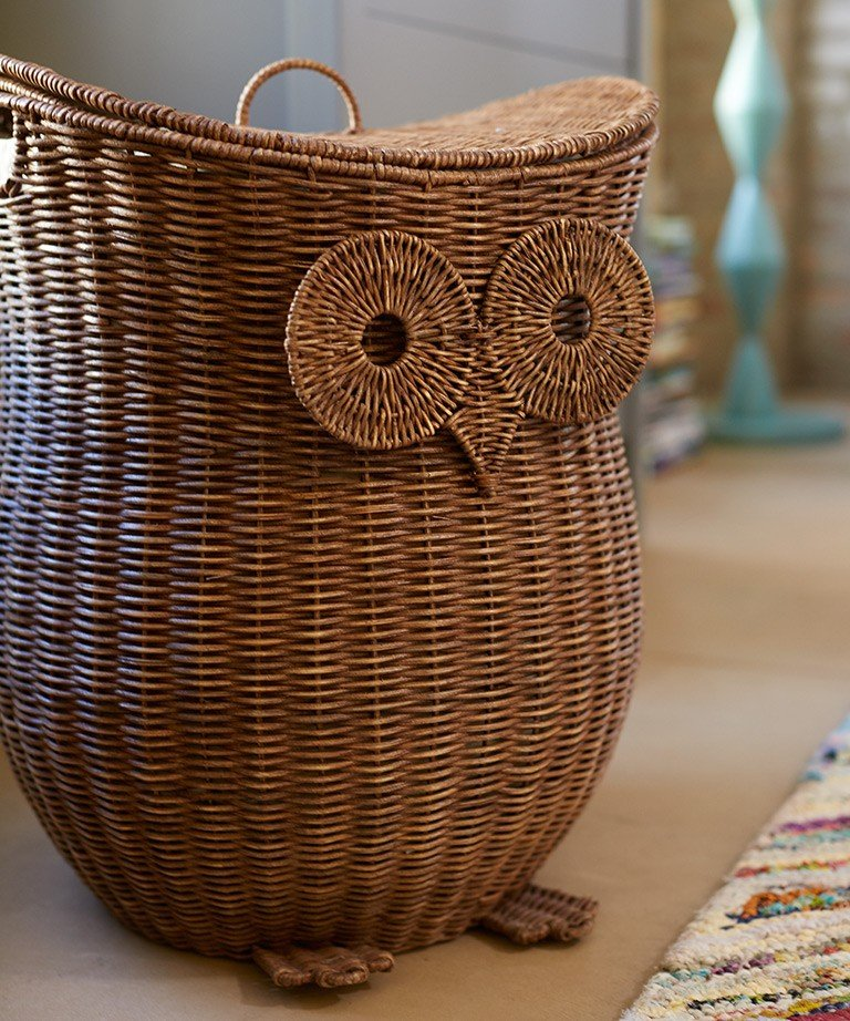 A wicker hamper shaped like an owl.