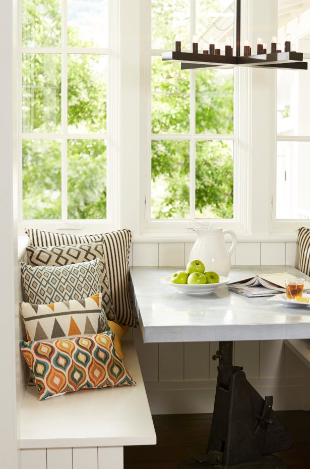 Try a built-in banquette for a small dining room