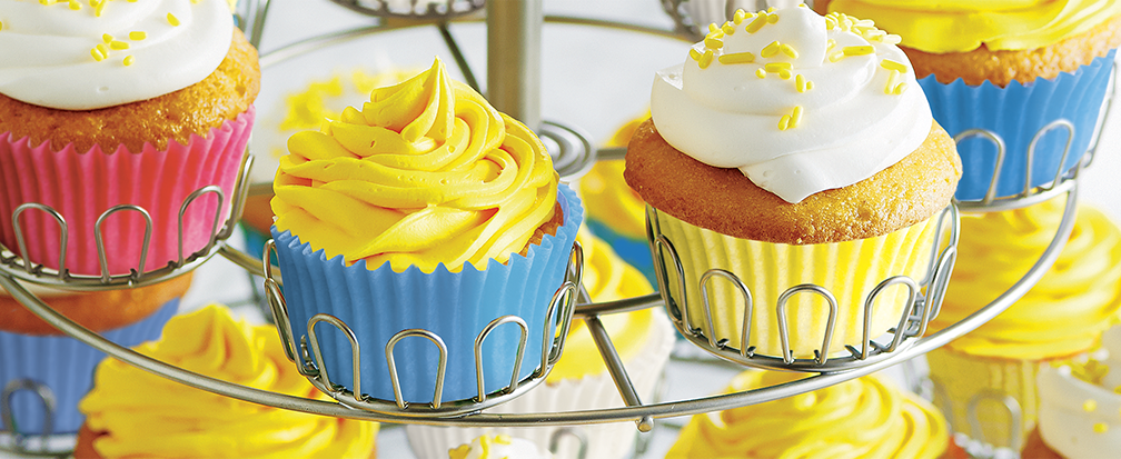 3-tier cupcake holder with blue and yellow cupcakes