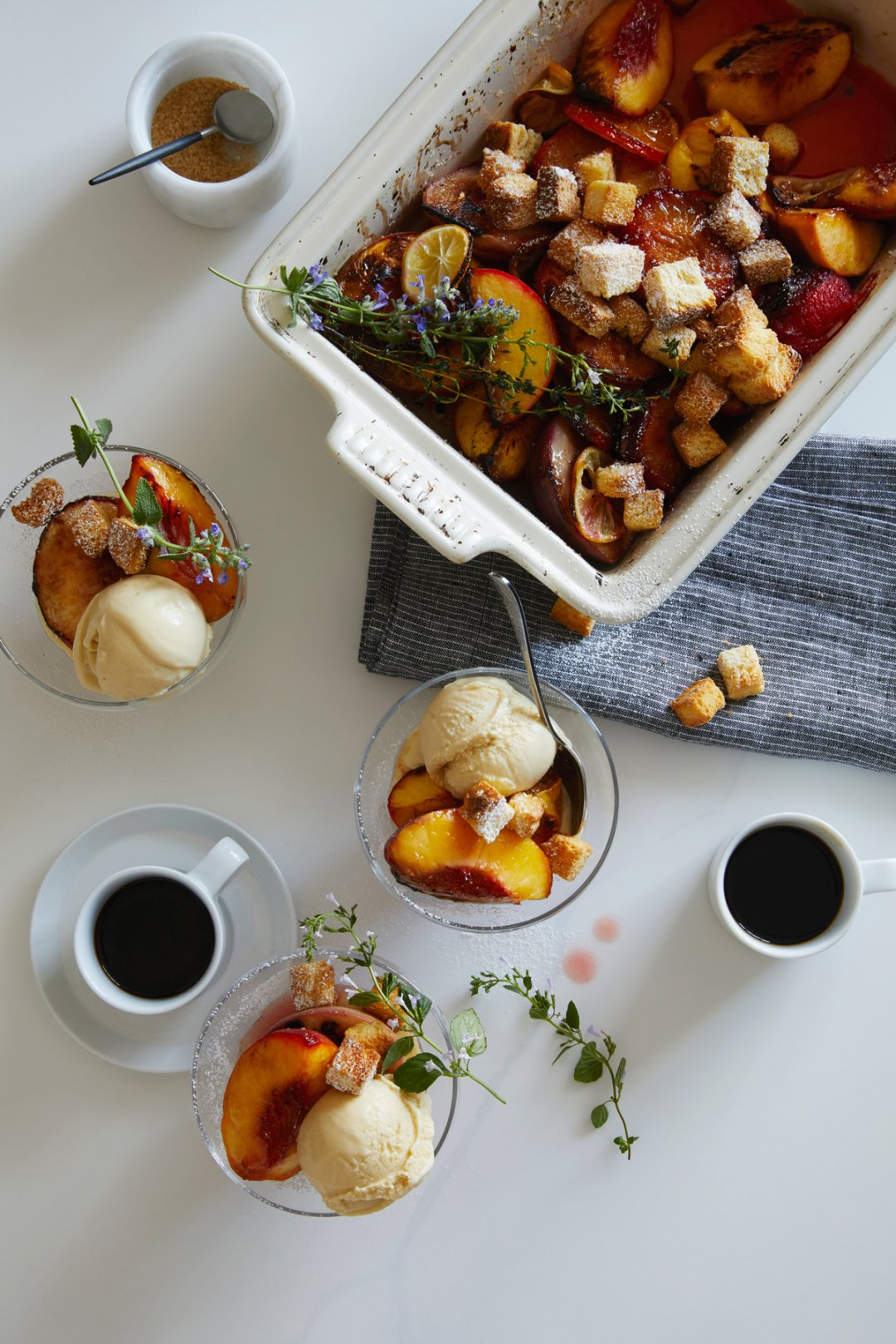 Salted Maple Ice Cream Sundaes with Caramelized Stone Fruit in Le Creuset baker and footed dessert dishes