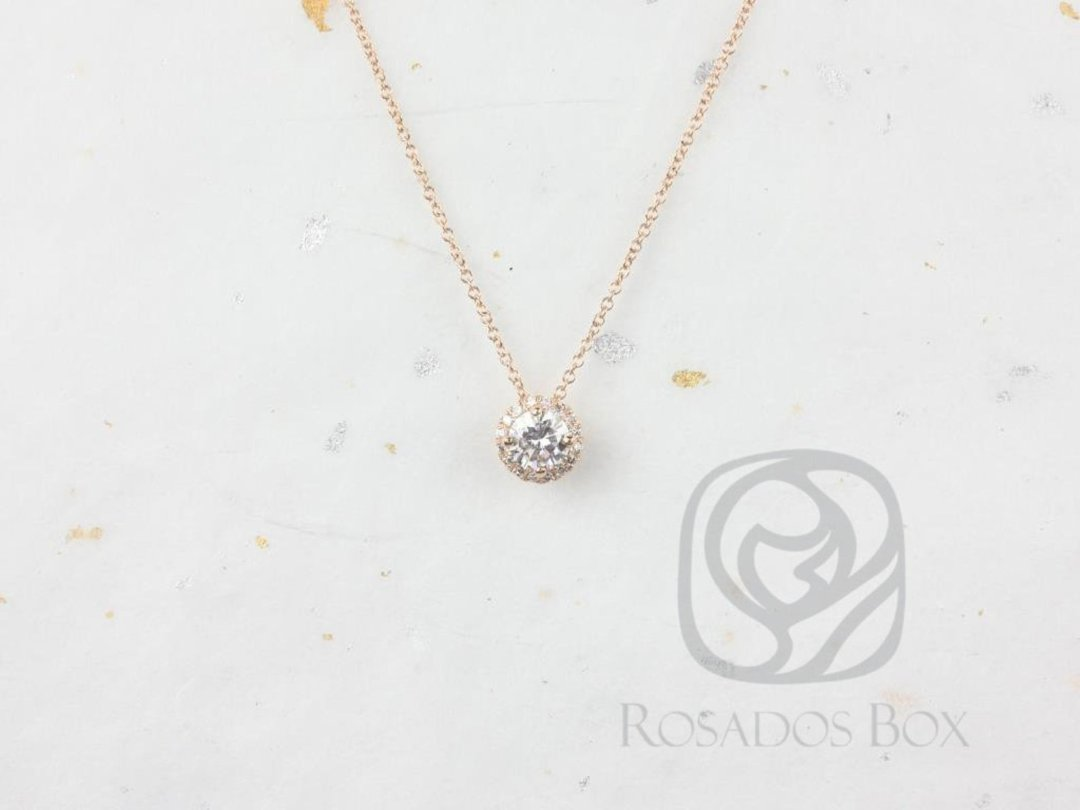 necklace with rose gold chain and diamond halo surrounding a moissanite stone