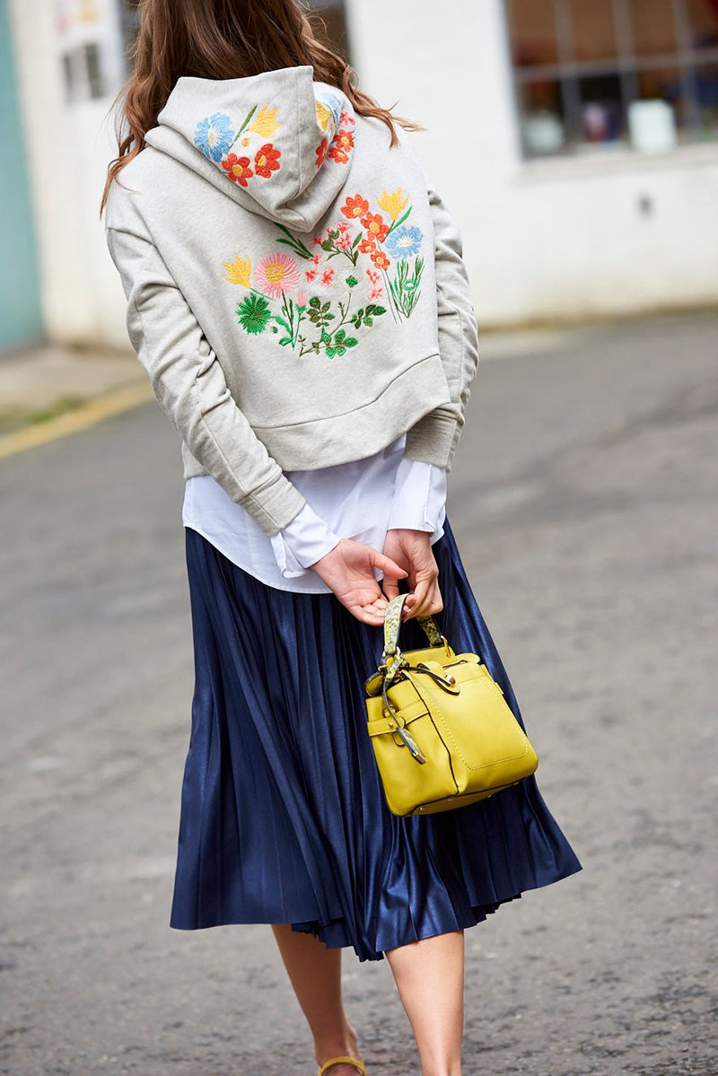Embroidered hoody and pleated skirt