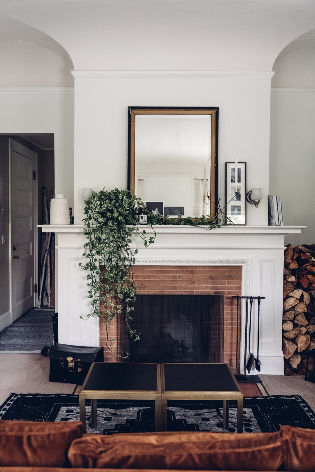 Red brick fireplace with mirror on mantel