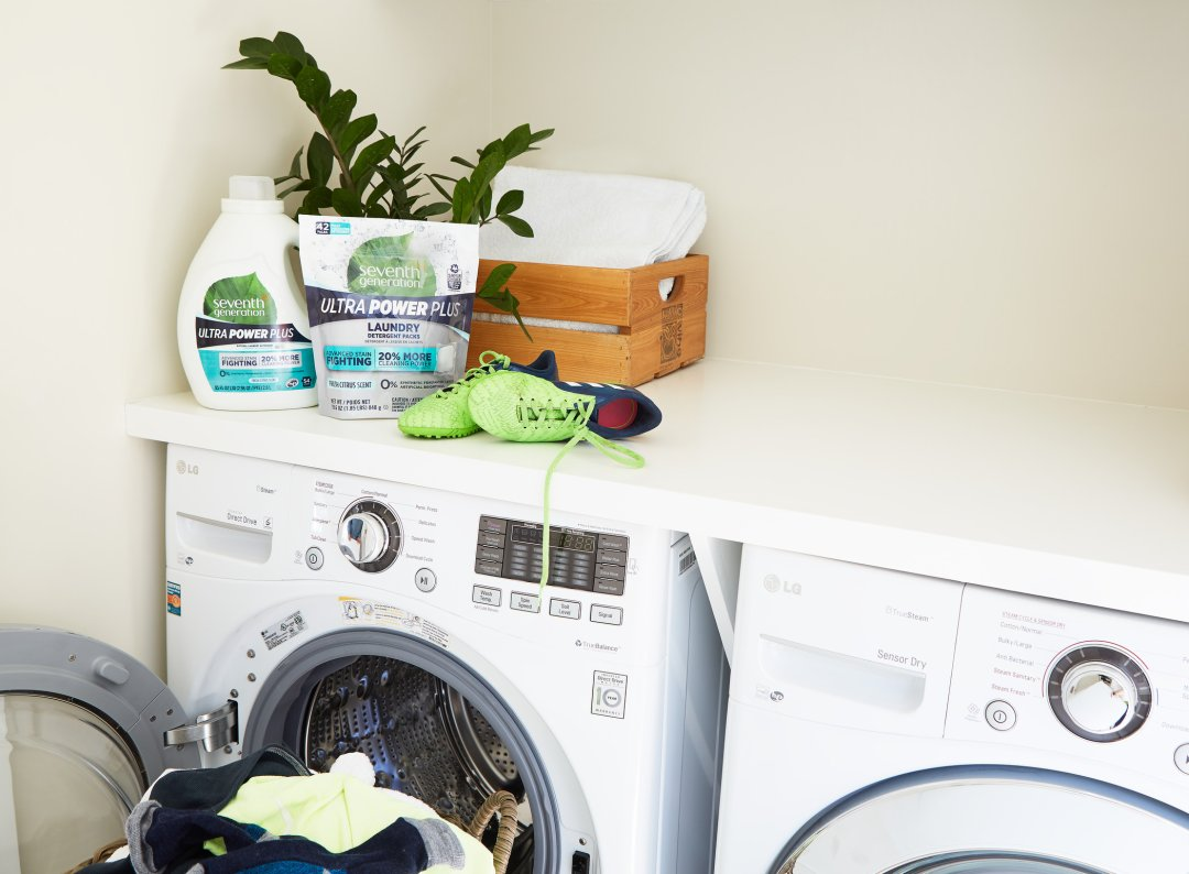 Ultra Power Plus Liquid Laundry and Packs on top of front load washer
