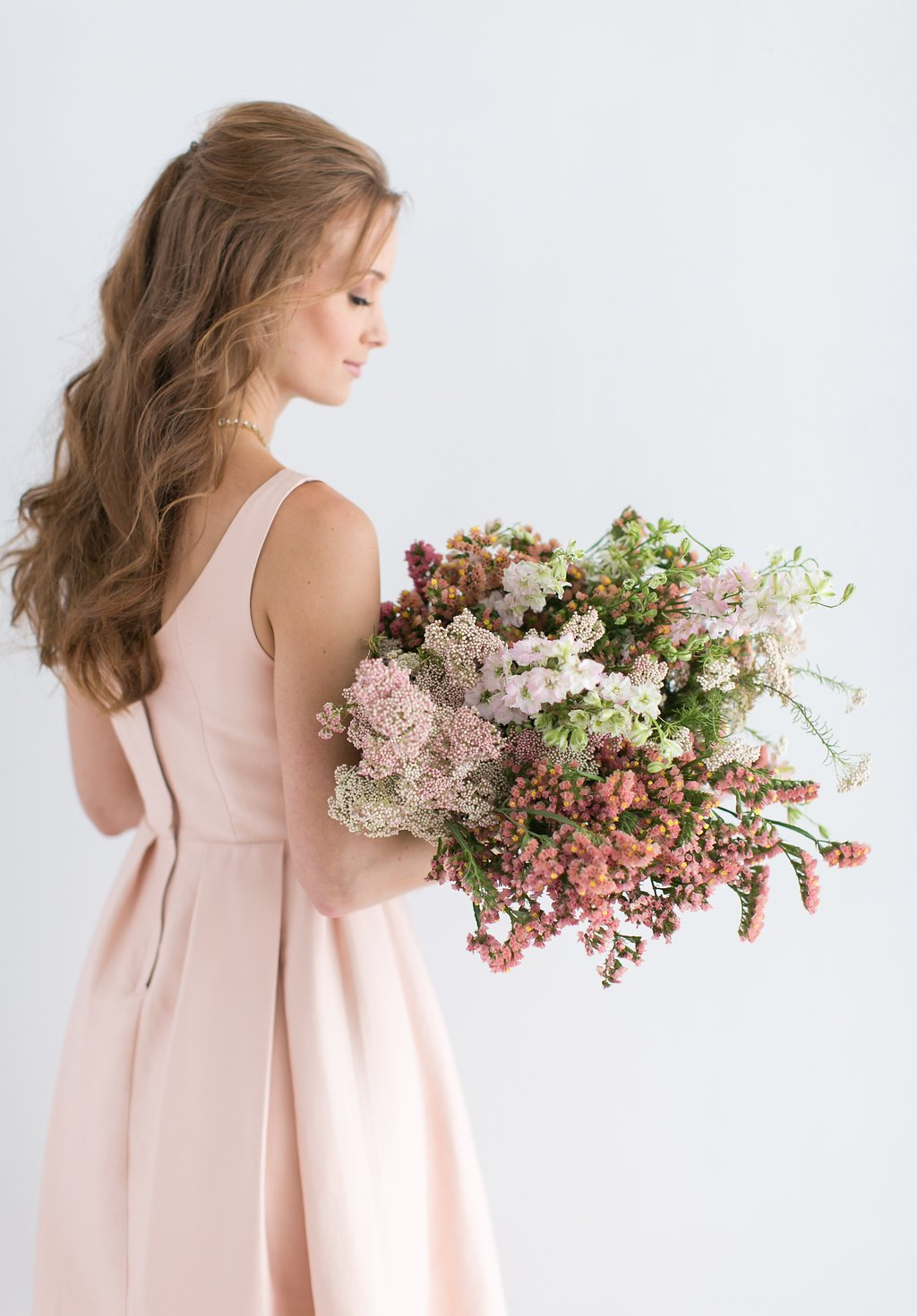 Bride holding wedding bouquet of spring flowers