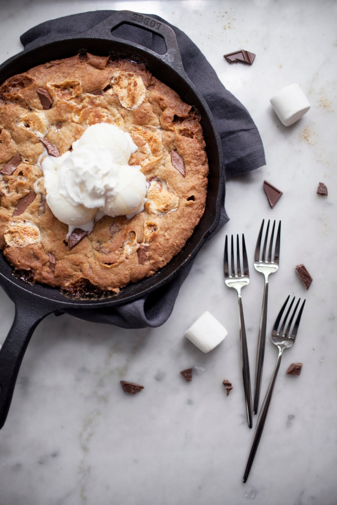 Cookie skillet with ice cream and three forks