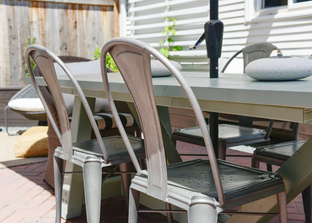 Two metal chairs at outdoor dining table