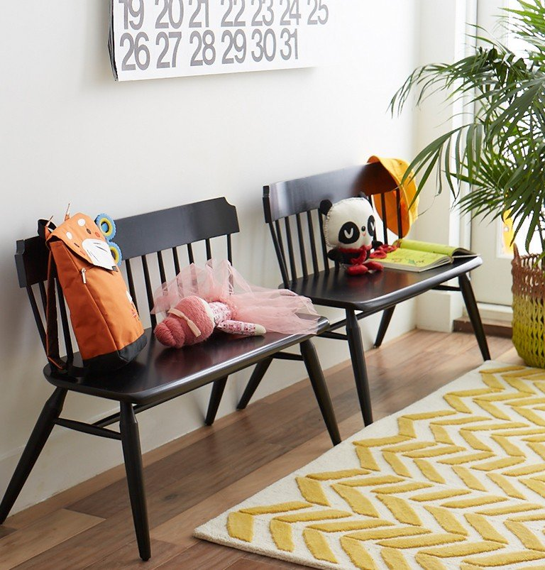 Large black benches make good storage for kids in an entryway