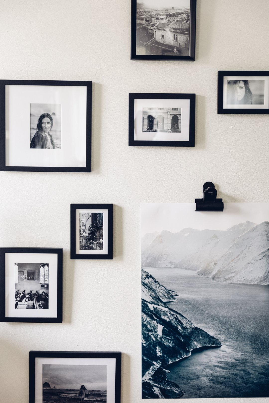 Black and white photo collage displayed in black frames